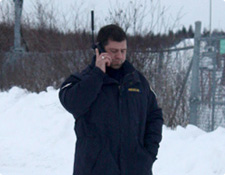 OVERT team member on a satellite phone